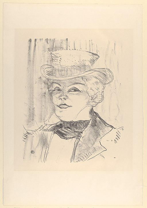 Portrait of the head and shoulders of a woman of the 1890s dressed in a man's top hat, tie, and jacket