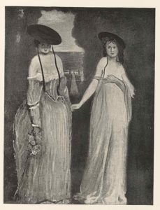 Two women holding hands, both wearing hats and dresses that expose cleavage. One woman is holding up her breasts.