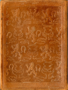 An embossed pattern of lions ans thistles on leather.